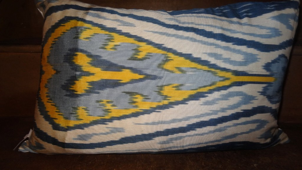 Blue and yellow traditional Ikat cushion