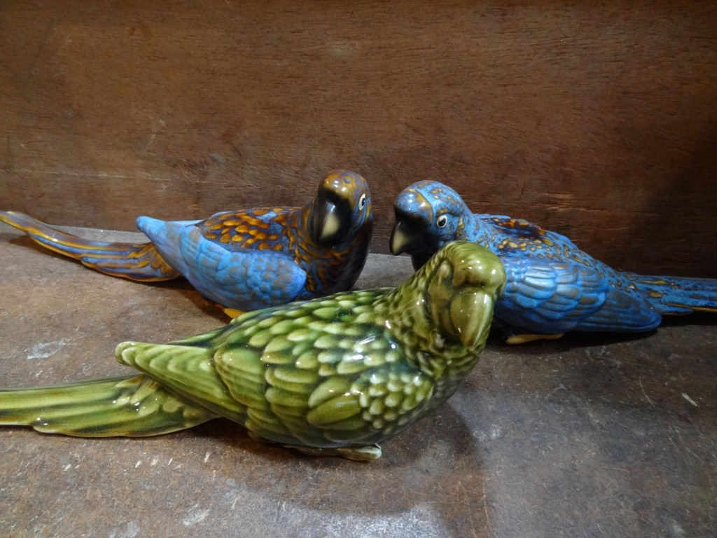 Green and blue ceramic parrots