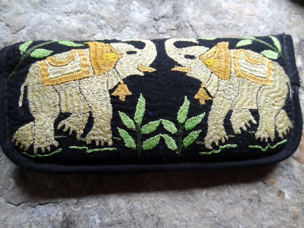 """Hand embroidered """"elephant"""" spectacle case in black embroidery made in Bangladesh."""