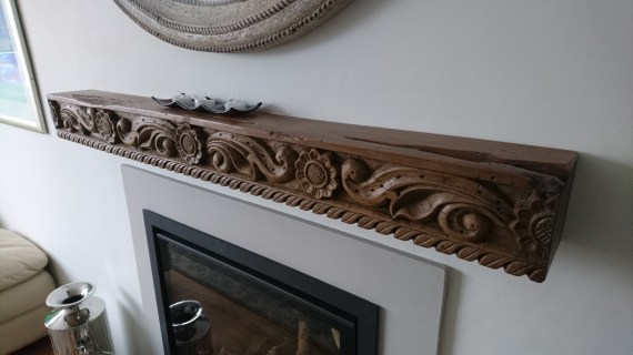 The customer has used this antique wood panel from Rajasthan and made it in to a mantlepiece.