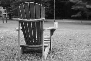 chair with coffee on lawn, calm and focus.