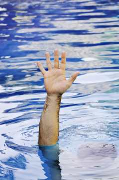 Hand of drowning man, overcome overwhelm with SaneSpaces.Com