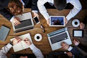 Modern business meeting, scheduling software.
