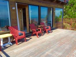 Our Large View Deck; with Master Bedroom on left + Living area on right inside.
