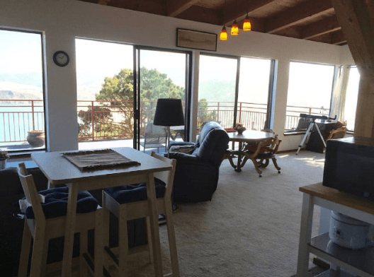 From kitchen to breakfast table, living, dining areas out to large deck and VIEW