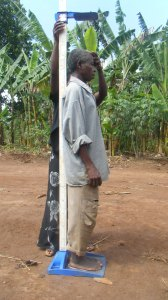 Data collection, measuring someone's height on uneven ground. credit: Georgina Murphy