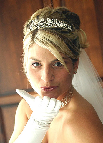 A Bride with Long Blond Formal Hairstyle with Tiara