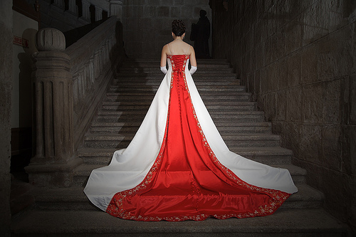 red colored wedding dress with long train
