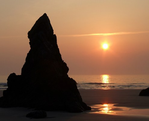 Sunrise can be enchanting on the beach especially with the geology around the waves