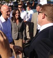 City photo, Sanibel Mayor Ruane (back to) talking to Governor Scott & Senator Benacquisto