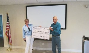 Realtor & Assoc Board Member, Lori Pierot making presentation to Jim Griffith for the International Osprey Foundation.