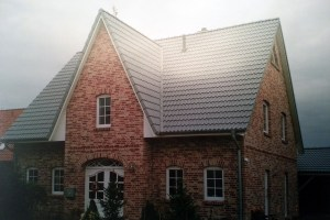 Neubau · Rohbau und Verblendung