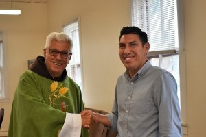 Fr. Vince congratulates Angel Ibarra.