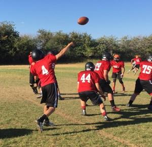 Quarterback Spencer Steadman hurls a long pass during North Sanpete football practice.