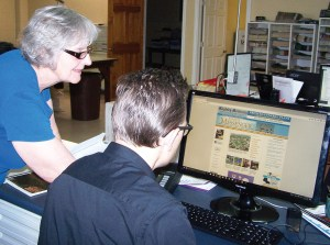 Messenger publisher Suzanne Dean and managing editor Robert Stevens work on a new, interactive Sanpete County website, which goes live Oct. 15.