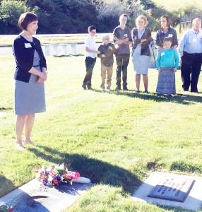 Danon Richardson Jones, a descendant of Sanpete settler Artemus Millett, presents a special wreath at the gravesite of her grandmother, Doralynn Millett Richardson, at the 29th annual commemoration of the Settlement of Sanpete. Jones is a fifth-generation descendant of Millett.