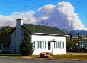The glare of the flames from the Fly Canyon Fire east of Spring City reflects off the smoke that dominates the horizon behind 92-year old Leah Larsen's Mt. Pleasant house.
