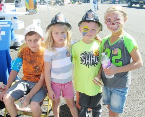 Ryder Coats, 8, is having his blood pressure checked at the Family Health and Safety Fair last Saturday. Continuing to the right are his sister, Rawlee Coates, 5; and their cousins, McCoy Coates, 6, and Atley Coates, 7. Rawlee, McCoy and Atley all got their faces painted at the health fair.