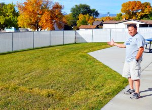 Gunnison Valley pool manager Kevin Harvey points to the location for the city splash pad, Construction on the facility will begin soon. The city plans to plave the 40-foot by 60-foot splash pad adjacent to the pool in the rear deck area. - Robert Stevens / Messenger photo