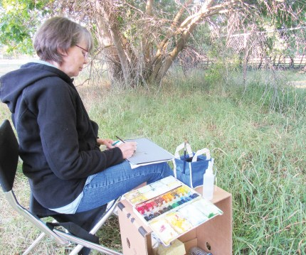 Spring City Arts board member Mary Fairbanks is in her element using watercolors to paint what she saw on nature's canvas.