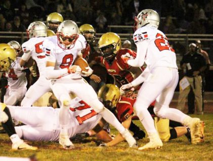 Mac Stevens spins away from the defense in the Templars' loss to Juab. - Photo courtesy Kenny Kirkham