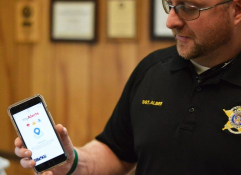 Sgt. Jason Albee of the Sanpete County Sheriff's Office shows how an alert, or emergency message, sent out by the dispatch center can be received through the myAlerts app on his cell phone.