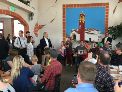 Presidential Candidate Evan McMullin (standing near center in a blue coat) and his running mate Mindy Finn spoke to supporters at Malena's Café in Ephraim during a visit to the county last Saturday. - Matt Harris / Messenger photo