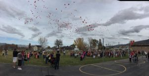 Students at Manti Elementary released dozens of red balloons to finalize Red Ribbon Week on Nov. 4. The balloons served as a promise to never do drugs. - Daniela Vazquez / Messenger photo