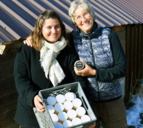 Zina (left) and Lee Bennion display a case of the handcrafted skin salve that Lee developed and the two have marketed into a blossoming family business from home on their Spring City property. - Steve Olpin / Messenger photo