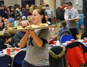 Students from Gunnison Valley High School volunteered as servers, bringing plates of hot food around to banquet attendees.