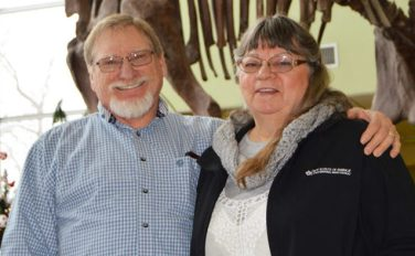 """David and Roberta """"Bobbie"""" Brown (right) of Mt. Pleasant stand in front of the Fairview Museum's mammoth skeleton. David Brown and his wife are the new museum curators. - Robert Stevens / Messenger photo"""