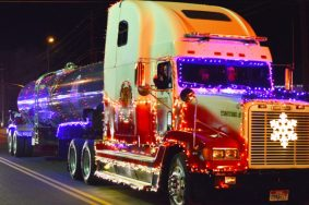 The Ephraim Fire Department shined their big rig and decorated it with Christmas lights to ride in the Ephraim City Light Parade. - Robert Stevens / Messenger photo