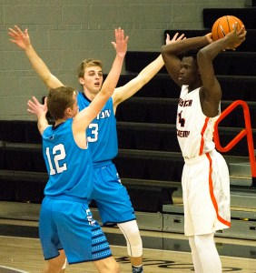 Junior Guard Emmanuel Akot looks to pass in the Tigers' game against Layton. Wasatch crushed the Lancers, 87-53.