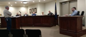 David Strate (at podium), owner of JD Trailer Court, faces off with the Ephraim City Council and City Manager Brant Hanson (at desk on right) during Jan. 4 council meeting. The council gave Strate two more weeks to submit a mitigation plan for problems at the trailer court. - James Tilson / Messenger photo