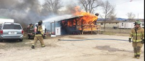 Gunnison Valley firefighters battle a trailer fire at Centerfield's Main Street trailer court. According to the trailer owner, the structure and all belongings inside it were a total loss.