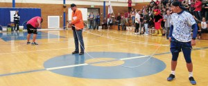 J.D. Fox of Sky 93.7 (Mid-Utah Radio Group) helps students of Manti and Gunnison Valley get hooked up to opposite ends of a bungee cord for the bungee basketball event.