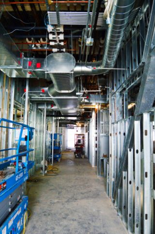 A modern ventilation and climate control system has air ducts snaking through the walls and halls of Snow College science building, currently under construction.