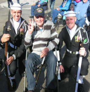 """World War II vet James Nichol, of Mt. Pleasant, shows his best """"V is for Victory"""" sign, flanked by two military drill team members during his Utah Honor Flight to Washington, D.C. in October."""