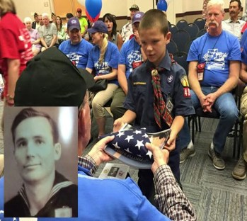 A Cub Scout hands James Nichols, a World War II vet from Mt. Pleasant (see inset service photo), a folded U.S. flag during a ceremony recognizing the service to their country of him and 49 other veterans. The flag ceremony was one of many events held to honor the veterans during the October Utah Honor Flight to Washington, D.C.