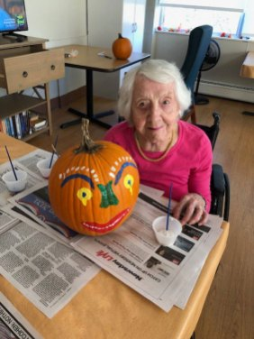 Resident decorating pumpkin