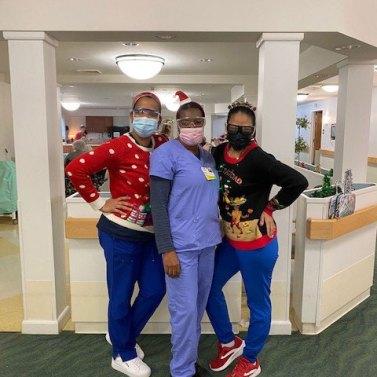 3 San Simeon staff members in Christmas attire