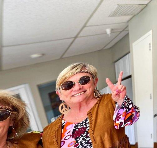 San Simeon female faculty member dressed in hippy clothing