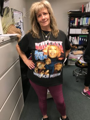 female San Simeon staff member wearing band t-shirt