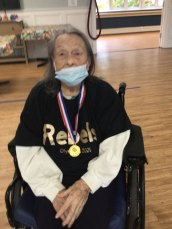 female San Simeon resident with medal from Olympic games