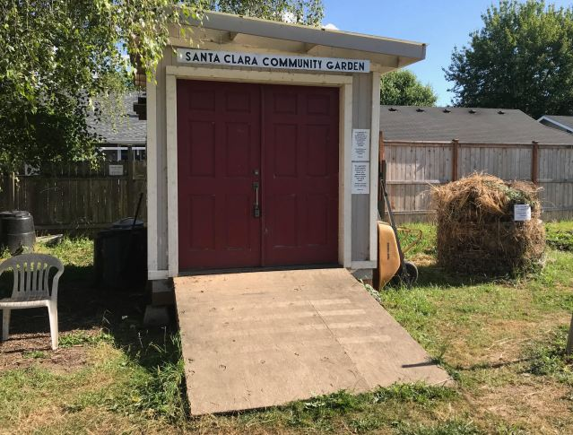 The Santa Clara Community Garden shed sits immediately behind St. Matthew's church.