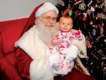 pajamas-child-with-santa-at-santa-claus-christmas-store