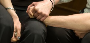 Trafficking victims hold hands and support each other