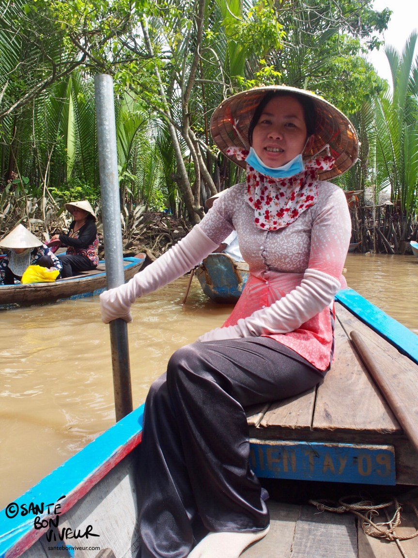 Vietnamese Woman Rowing a Sampan in the Mekong Delta, Vietnam, 2017