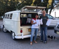 John and Cindy Mason with their dog Leah help set up for the Luminary Festival with their 1967 VW van