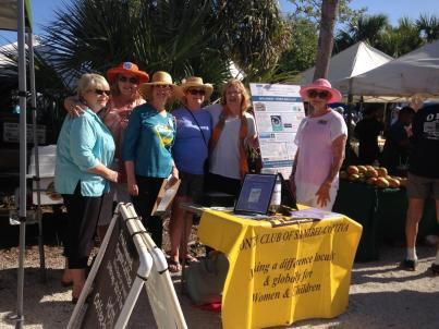 Zontians selling raffle tickets at the Sanibel Farmer's Market in 2018